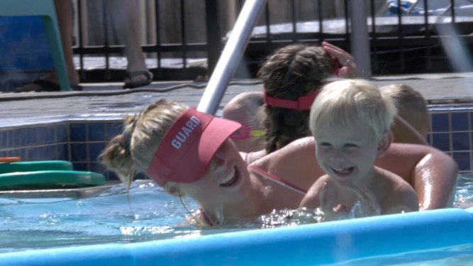 Kids and Lifeguard playing in pool